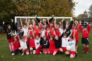05/11/14 - Radio DJ Chris Evans with children of Weeke Primary School with one of the new football nets he presented to the school. Nine-year-old pupil Tobey Fergusan contacted Chris' radio show after his football team were forced to play using tiny goals. Photo: Ian Hinchliffe